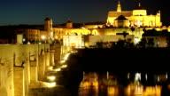 Spain. Cordoba. Roman bridge and Mezquita at night video