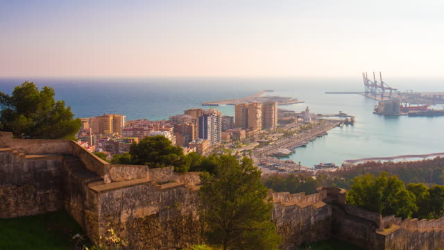 spain malaga sun light castle view on sea bay 4k time lapse video