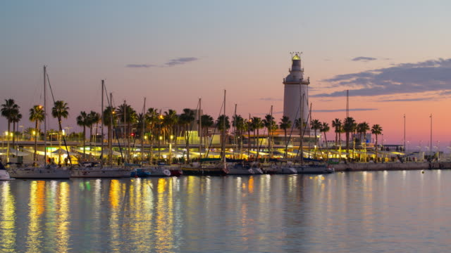 spain malaga sunset private yacht dock lighthouse panorama 4k time lapse video