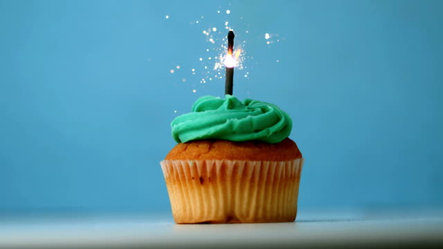 Sparkler burning on a birthday cupcake video