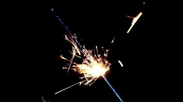sparkler fireworks burning on a black background, congratulations, greetings, party, happy new year video