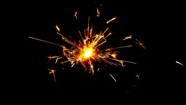 Sparkler over Black Background. Slow-mo video