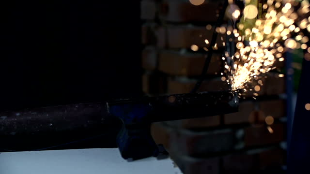 HD SLOW: Sparkles fly from electric grinder video