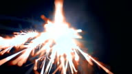 Sparks fly at the lens of the camera. Macro. Color correction. Slow-Mo video