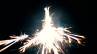 Sparks fly at the lens of the camera. Macro. Color correction video