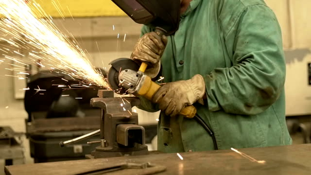 Sparks Flying from a Metal Grinder in Welding Shop video