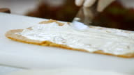 Spatula putting cream on shortcake. video
