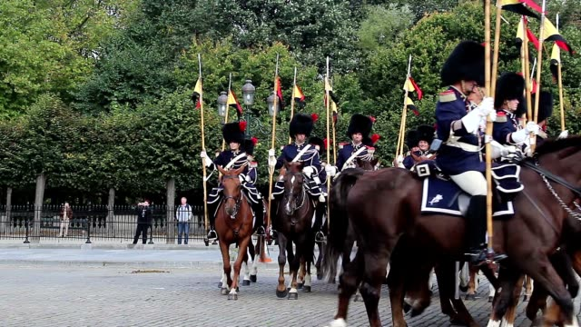 Spear men on horses parade, Belgium Royal Palace cavalry uniform. Beautiful shot of Europe, culture and landscapes. Traveling sightseeing, tourist views landmarks of Belgium. World travel, west European trip cityscape, outdoor shot video