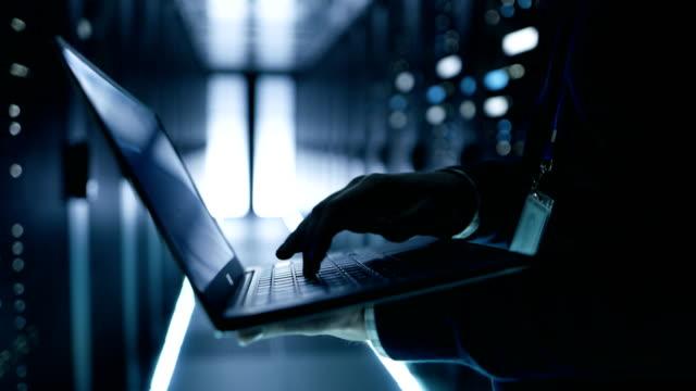 IT Specialist Working Working on a Laptop, He's Employee of  Big Ultramodern Data Center. video