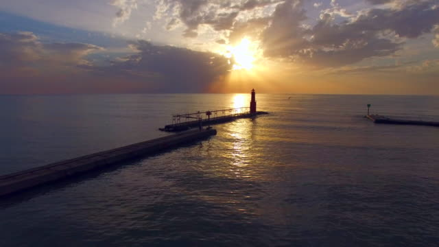 Spectacular, breathtaking sunrise over Lake Michigan, with lighthouse video
