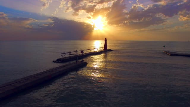 Spectacular, breathtaking sunrise over Lake Michigan, with lighthouse. video