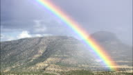 Spectacular Rainbow Over Bell Mountain  - Aerial View - New Mexico, Catron County, United States video