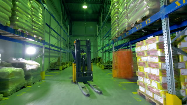 A speedy turn of a warehouse stacker during work. video