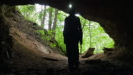 Spelunker Enters Cave with LED Headlamp video