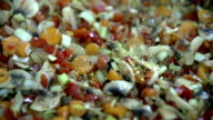 HD SLOW: Spicing the vegetables in big dish video