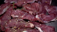 HD SLOW: Spicing up the meat with different sorts spices video