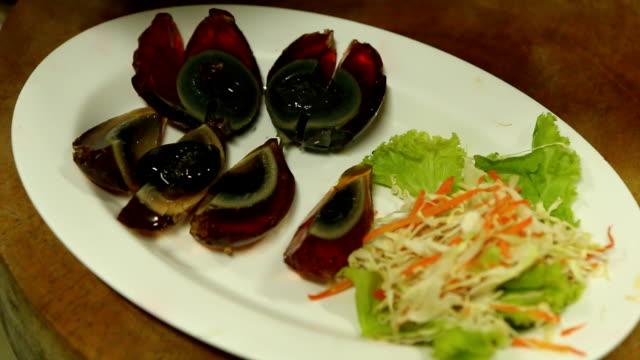 Spicy black preserved eggs salad. video
