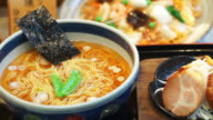 Spicy Japanese ramen noodles with spicy soup, pork and seaweed video