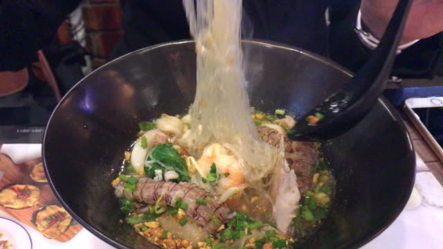 Spicy noodle with crayfish and seafood , Bangkok , Thailand. video