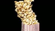 Spilling popcorn, slow motion video