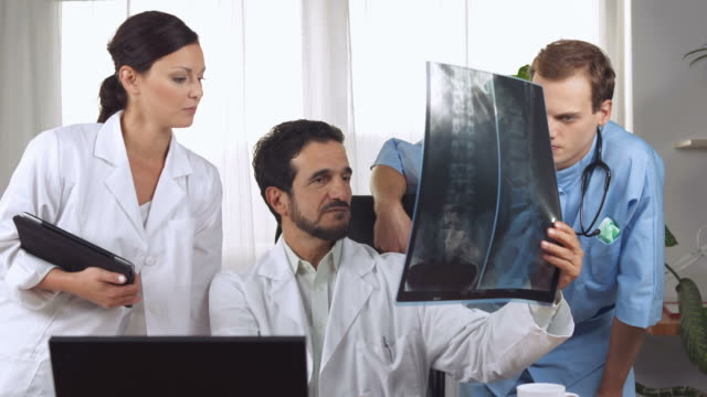 HD DOLLY: Spine Surgeons Examining X-Ray video