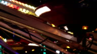 Spinning carousel in amusement park at night video