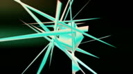 Spinning geometric object exploding into polygonal shards video