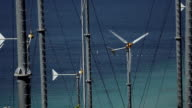 Spinning turbine blades at wind farm on the shore video