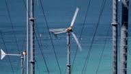 Spinning turbine blades at wind farm video