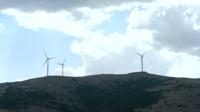 Spinning wind turbines on the hills video