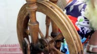 Spinning yarn with an old-time spinning wheel video