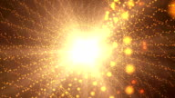 Spiral of golden particles and bright light background. video