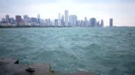 splashing crashing waves of Lake Michigan slow motion water Chicago skyline video