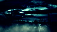 Spooky Halloween graveyard with dark stormy clouds, rains and thunders video