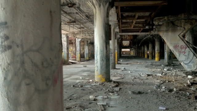 CLOSE UP: Spooky ruined garage in abandoned Fisher Body Plant automotive factory video