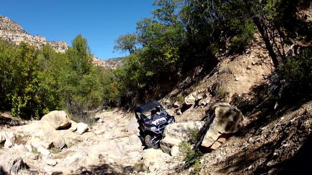 Sport 4x4 vehicle climbing rough steep mountain trail video
