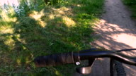Sport bike standing on the footpath in the park. video