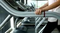 sport women jogging on treadmill cardio equipment video