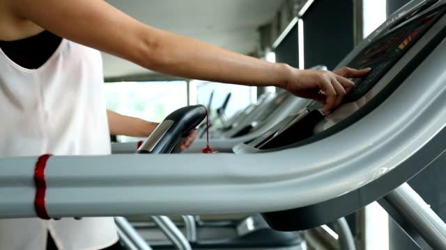 sport women running on treadmill cardio equipment video