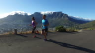 Sporting couple enjoying their run above the city video
