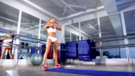 Sportive woman doing warm up in the gym video