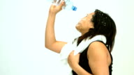 Sportive woman splashing her face video