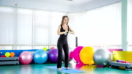 Sportive Woman Taking Chair Pose In The Gym video