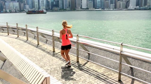 Sportive young woman jogging in Hong Kong video