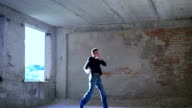 Sportmaster doing exercise in the catacomb. Slowly video