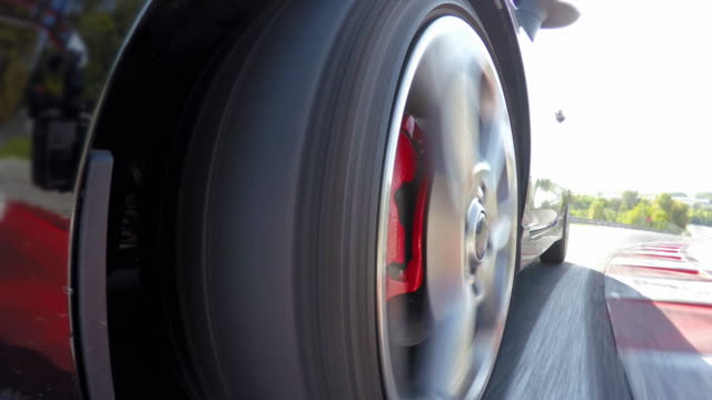 Sports car wheels spinning during a motorsport event competition video