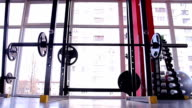 Sports club atmosphere, iron pumping equipment in the gym, healthy video