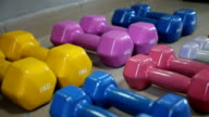 Sports dumbbells rubber in modern sports club. video