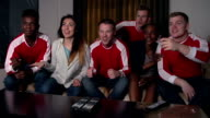 Sports Fans Watching Game On TV At Home In Slow Motion video