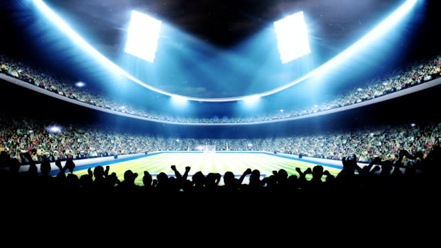 Sports field in light of spotlight video